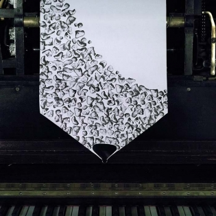 SKIZZEN HAND, silkscreen on pianola roll, 20cm x 12 meters, Collaboration with Dominic Murcott